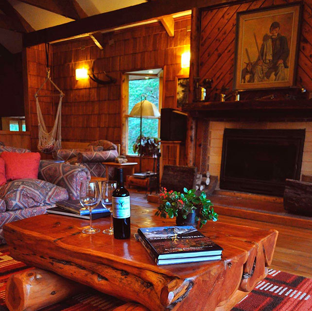 El Pangue Lodge located near Puyuhuapi in Patagonia, has an amazing club house with cabains and rooms, heated swimming pool and is next to Risopatron Lake